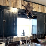 Black Kitchen Cabinets with Pallet Board Backsplash