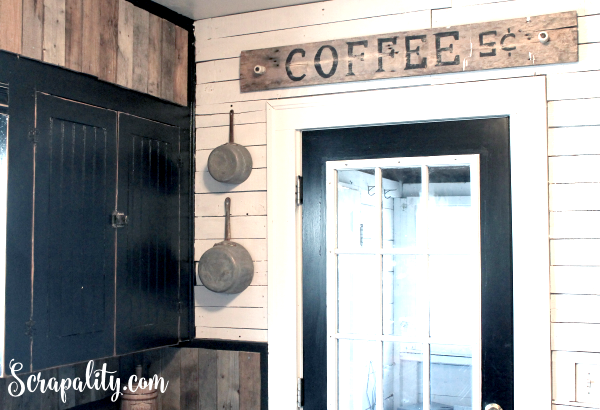 Old Coffee Sign Made From Pallet Wood Hung Above Door